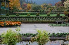 Italian garden in fall stock photography