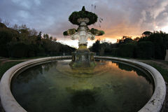 Italian Garden Fountain at dusk Royalty Free Stock Photography