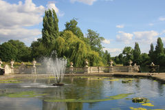 Italian Garden at Kensington Gardens. Kensington Gardens - Covering 111 hectares (275 acres), Kensington Gardens is planted with formal avenues of magnificent Stock Photos