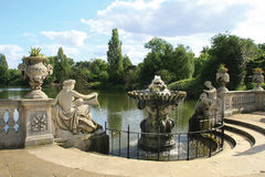 Italian Garden at Kensington Gardens. Kensington Gardens - Covering 111 hectares (275 acres), Kensington Gardens is planted with formal avenues of magnificent Royalty Free Stock Images