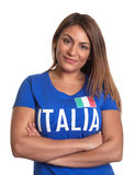 Italian girl with crossed arms. Beautiful italian girl with crossed arms in a blue soccer jersey looking at camera on an isolated white background Royalty Free Stock Photos