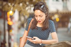 Italian girl looking at her smartphone royalty free stock image