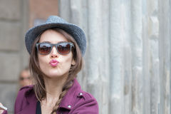 Italian girl sends kisses to her boyfriend. Italian girl with hat and sunglasses that sends kisses to her boyfriend Stock Photography