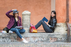 Italian girls are relaxing sitting reading a book Royalty Free Stock Photography