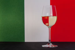 Italian glass of wine. The photo shows the glass of wine on the background of the Italian flag Royalty Free Stock Photography