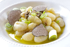 Italian gnocchi with onion and truffle Stock Images