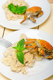 Italian gnocchi with seafood sauce with crab and basil Stock Image