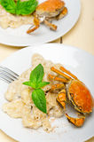 Italian gnocchi with seafood sauce with crab and basil Stock Photo