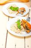 Italian gnocchi with seafood sauce with crab and basil Royalty Free Stock Images