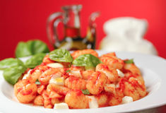 Italian gnocchi Sorrento style. Traditional italian gnocchi with fresh basil leaves Stock Photos