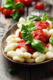 Italian gnocchi with tomato and basil Royalty Free Stock Images