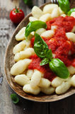 Italian gnocchi with tomato and basil. Selective focus Stock Photo