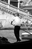 Italian gondolier and tourists Royalty Free Stock Image