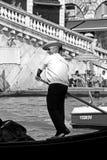 Italian gondolier and tourists Royalty Free Stock Image