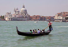 Italian gondolier and tourists Stock Image