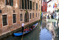 Italian gondoliers and tourists in Venice Stock Photography
