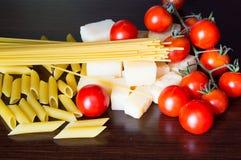 Italian grana padano, pasta and tomatoes Stock Photos