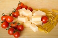 Italian grana padano with pasta and tomatoes Royalty Free Stock Image