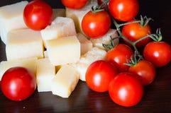 Italian grana padano and tomatoes Stock Images