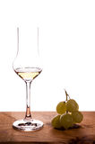 Italian grappa with grapes Royalty Free Stock Photo