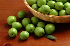 Italian green olives. Italian olives in a wood table Stock Photography