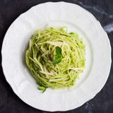 Italian green pasta spaghetti with pesto green peas, mint Stock Images