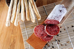 Italian grissini and salame Royalty Free Stock Photo