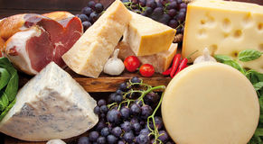 Italian ham, cheese and red grapes Stock Images
