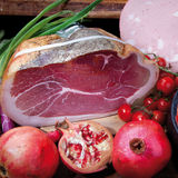 Italian ham with pomegranates Royalty Free Stock Image