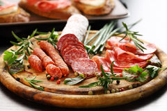 Italian ham and salami with herbs. Different Italian ham and salami with herbs royalty free stock photography