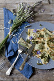 Italian handmade pasta ravioli with borage herb, flower, sage, crisp onion Royalty Free Stock Photo