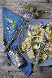 Italian handmade pasta ravioli with borage herb, flower, sage, crisp onion Royalty Free Stock Image