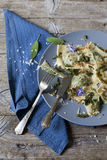 Italian handmade pasta ravioli with borage herb, flower, sage, crisp onion Royalty Free Stock Photography