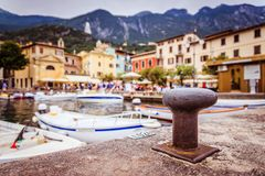 Italian harbour, small cute village in the blurry background. Italian harbour scene, boats in the blurry background port haven harbor italy holiday summer stock photo