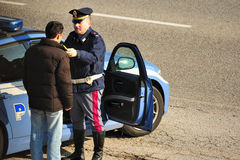 Roadside sobriety test. Italian highway police does an alcohol test Stock Images