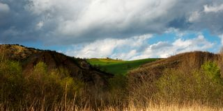 Italian hills. Landscape under moody sky stock photos