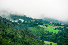 Italian hillside town in the morning mist Stock Image