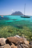 Italian holiday. Sardinia landscape with boats and tavolare island, Italy Stock Photography