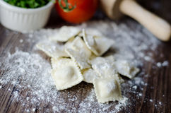 Italian home made ravioli. Cooking Italian home made ravioli in wood board royalty free stock photography
