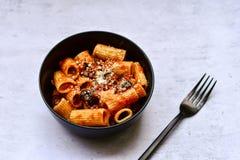 Pasta alla puttanesca. Italian home made sedani alla puttanesca Olives and tomato sauce royalty free stock images