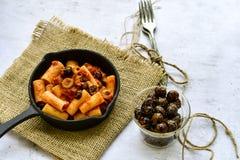 Pasta alla puttanesca. Italian home made sedani alla puttanesca Olives and tomato sauce stock photos