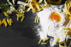 Italian homemade pasta with wheat flour and egg on black backgro Royalty Free Stock Photos