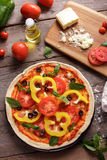 Italian homemade pizza sliced paprika topping with ingredients Stock Image
