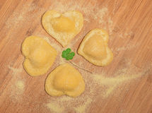 Italian homemade ravioli in the shape of clover. Stock Photo