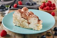 Italian Homemade Tiramisu Cheesecake on Vintage Background. Triangular Slice of Tiramisu with Coffee, Mascarpone Cheese and Cocoa on Vintage Background with Royalty Free Stock Image