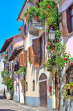 Italian house decorated with flowers in Piedmont, Italy. Royalty Free Stock Images