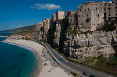 Italian houses fronting the sea on cliff over Stock Photos