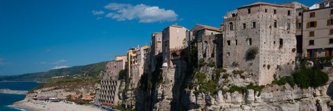Italian houses fronting the sea on cliff over Royalty Free Stock Image