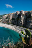Italian houses fronting the sea on cliff over Stock Photo