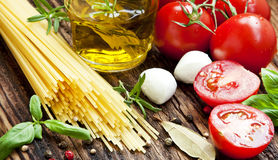 Italian Ingredients, Spaghetti,Olive Oil, Spices, Cherry Tomatoe Royalty Free Stock Photos